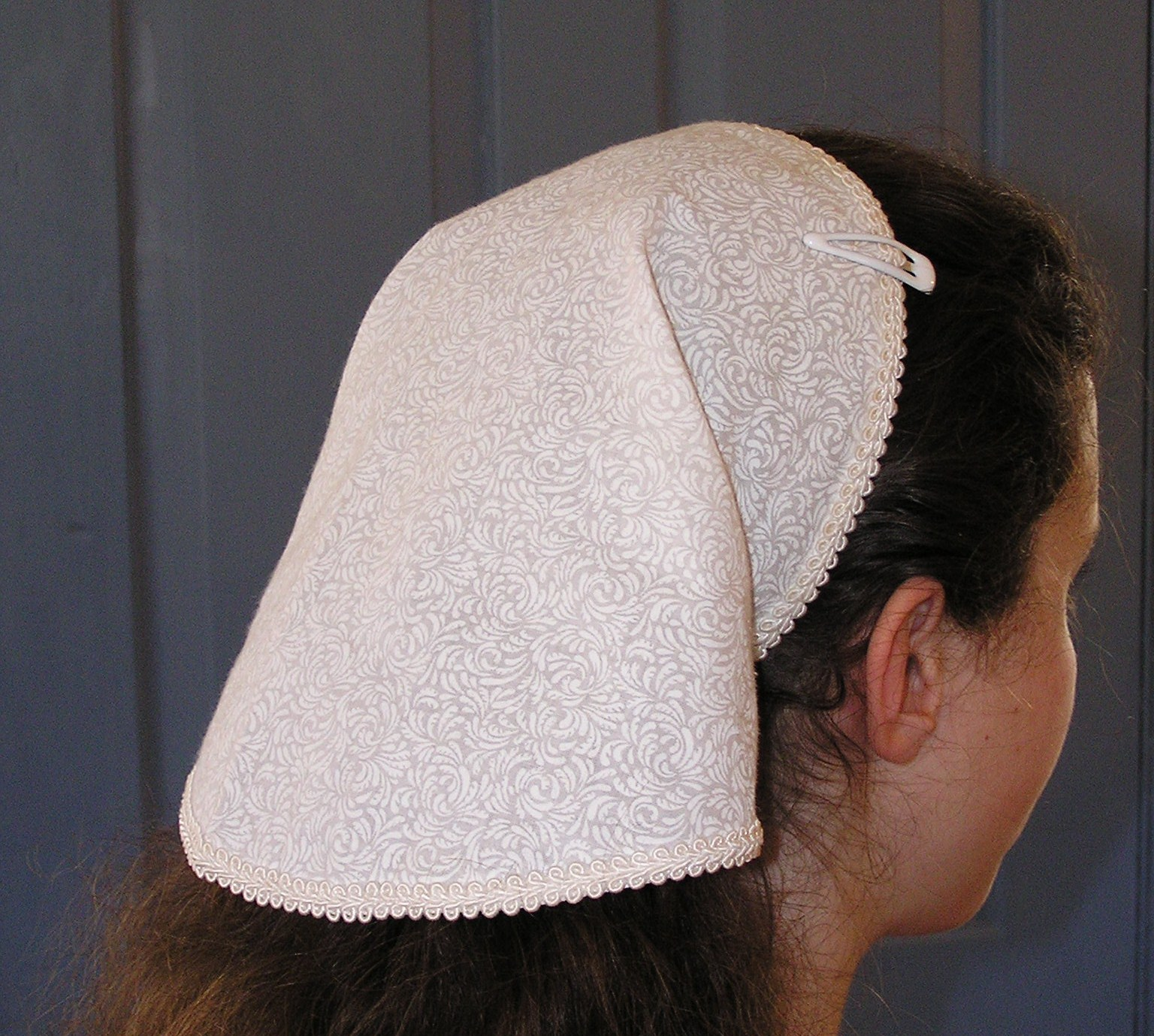 A girl with a head covering
