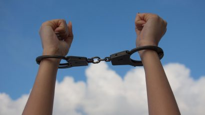 Persecuted hands in handcuffs