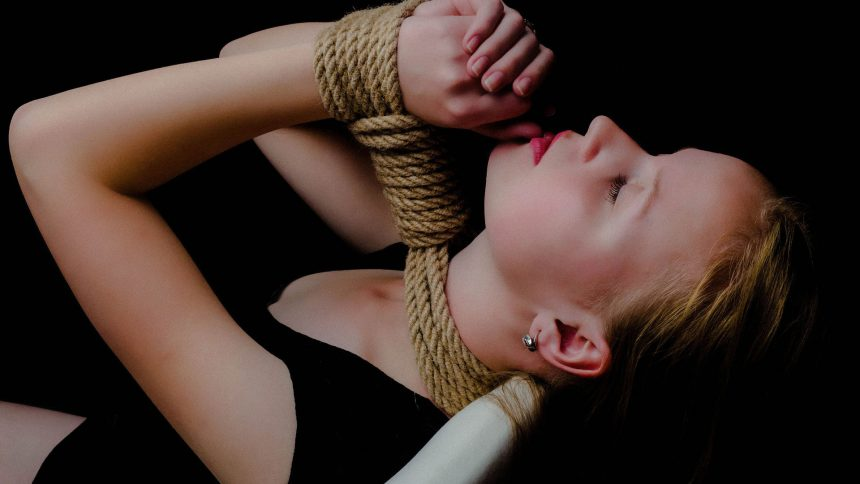 Young woman tied up, just like vows bind